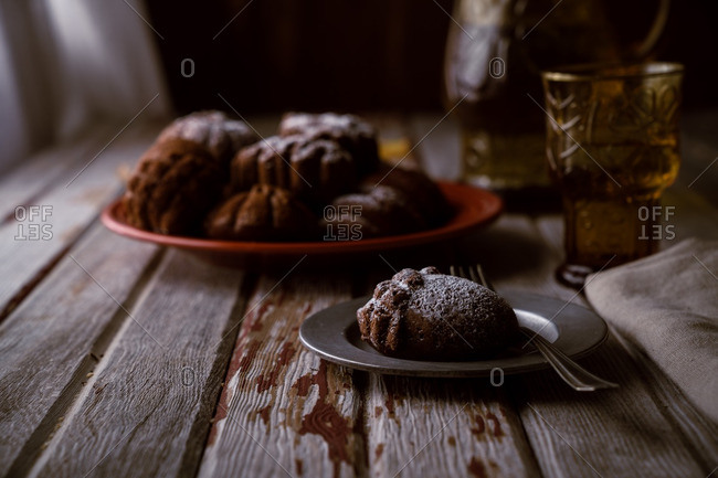 Acorn cake on plate on rustic wooden table