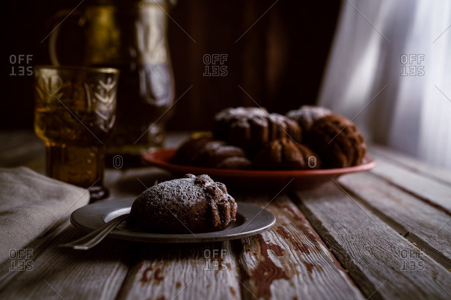 Acorn cake with powdered sugar on rustic wooden table