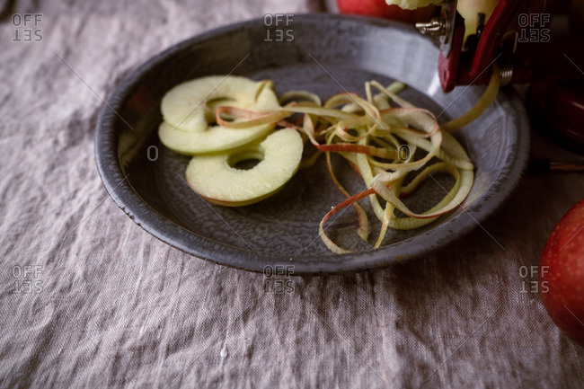 Sliced apples and apple peels in pie plate
