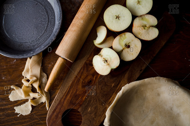 Close-up of pie crust with apple slices on cutting board