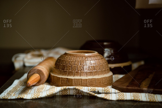 Mixing bowl and rolling pin on kitchen towel