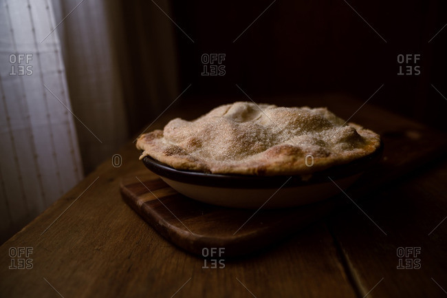 Freshly-baked apple pie with sugar coated crust