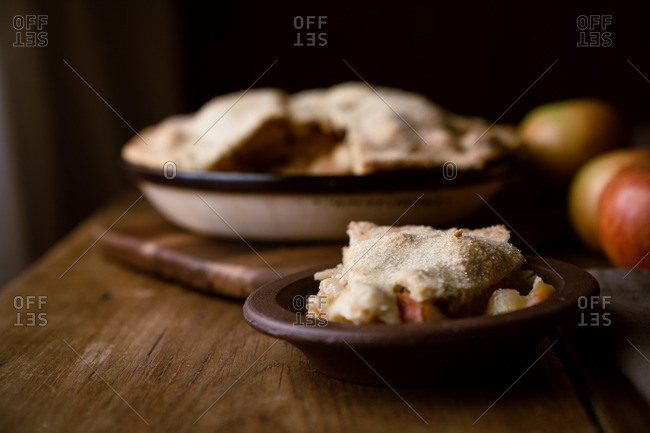 Slice of apple pie with sugary crust