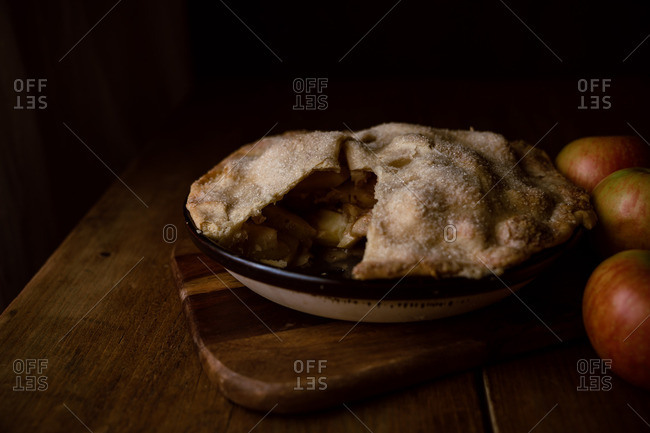 Homemade freshly baked apple pie with slice removed