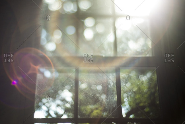 Lens flare from sunlight coming through a window