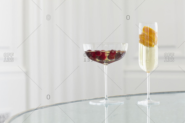 Cocktail glasses with fruit and sparkling beverage