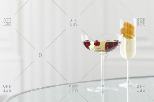 Cocktail glasses filled with sparkling beverage and fruit