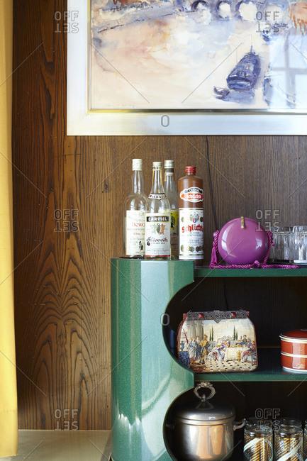 October 7, 2014: Bottles of liquor on a retro green shelf