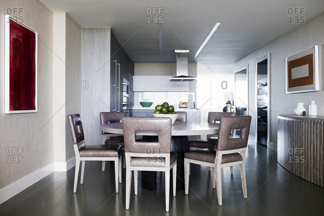 Dining table and chairs in a modern kitchen and dining room