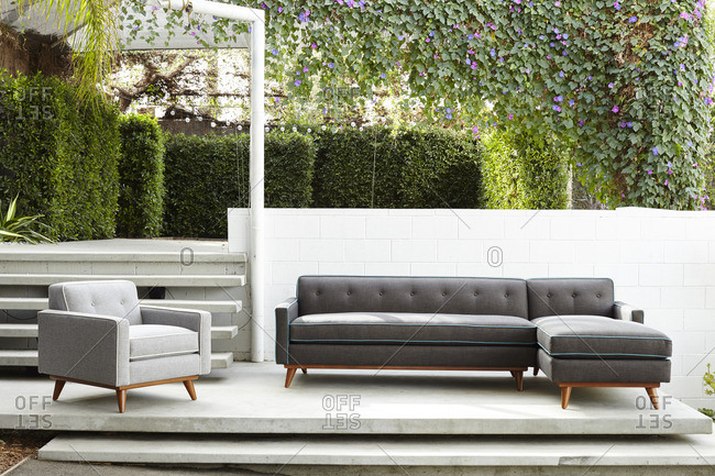 Gray sofa with blue piping on a modern patio terrace