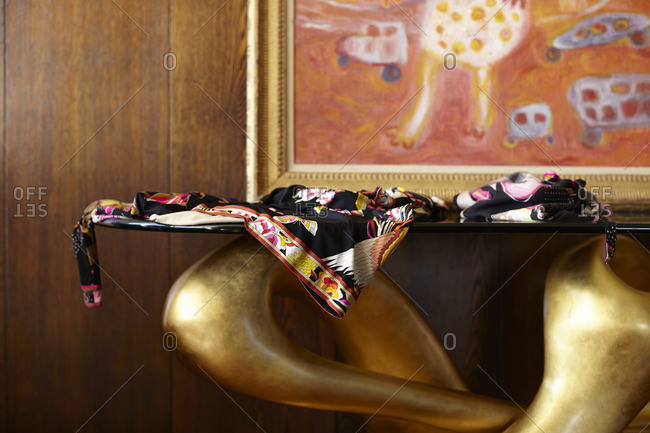 Floral patterned cloth on the edge of a modern sculpted table