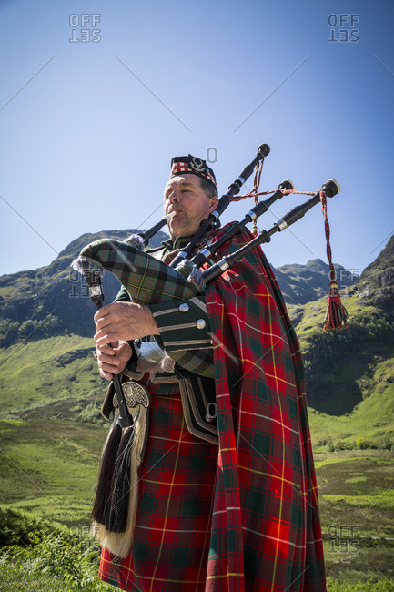 Bagpiper playing bagpipes at Three Sisters mountains