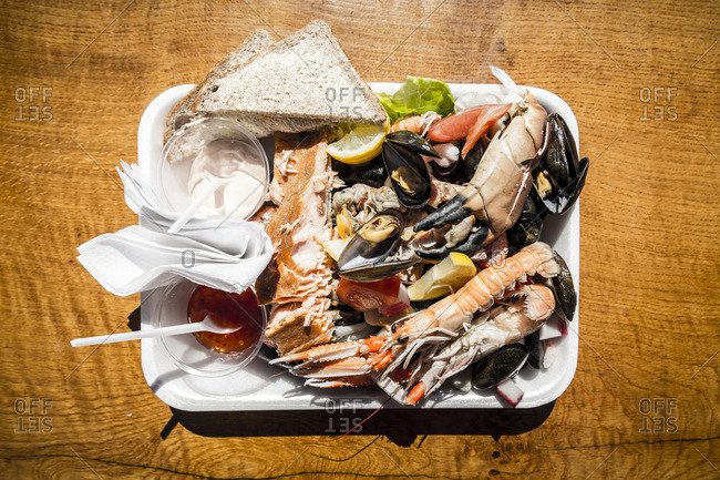 Overhead view of plate filled with seafood