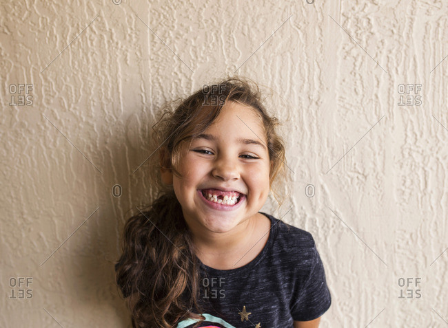 Portrait of a smiling girl with a missing front tooth