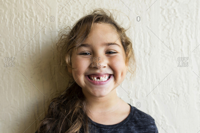 Portrait of a girl with a missing front tooth
