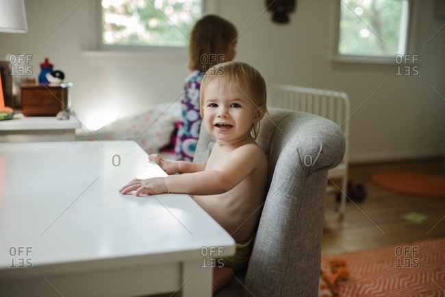 Baby sitting at a desk