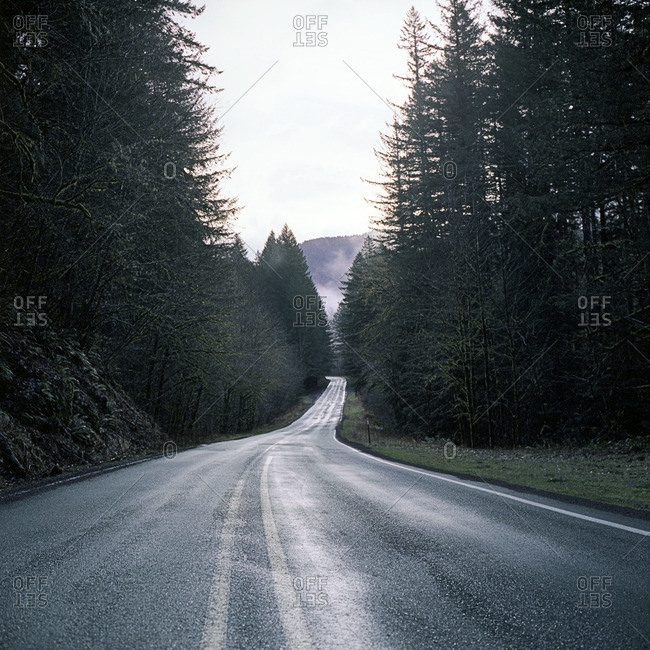 A road going down rural hill