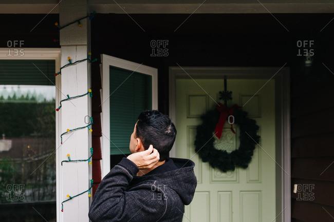 Man evaluates exterior Christmas lights