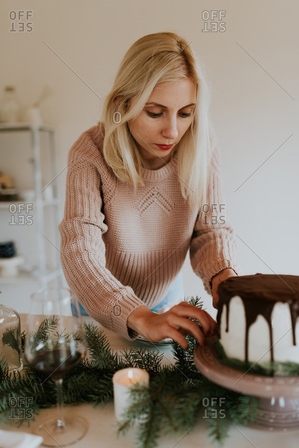 Woman decorating a holiday dessert table