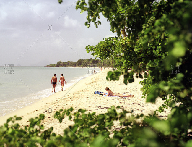 Beachgoers on Sainte-Anne Beach with a view of the Caribbean sea