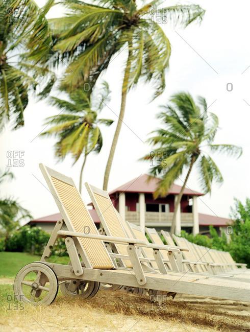 Beach chairs at Le Cap Est Lagoon Resort & Spa, Martinique. Eastern Caribbean.
