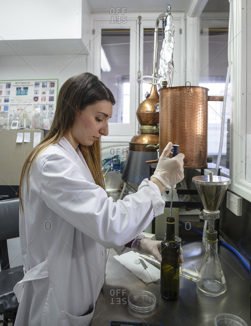 Agros, Cyprus - May 7, 2015: Woman doing microbiology tests for rose water at the Venus Rose cosmetics plant