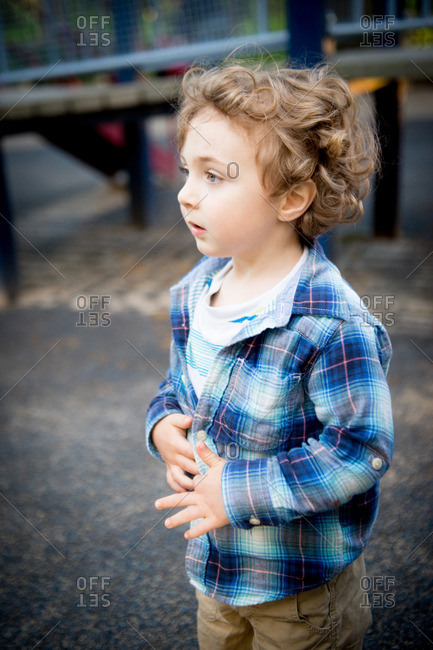Portrait of a boy standing at playground