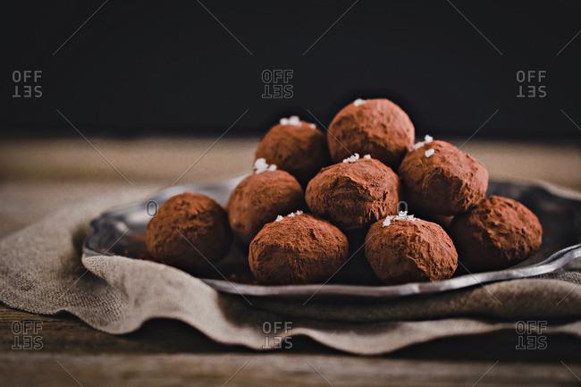 Vegan chocolate truffles served on a plate