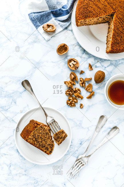 Piece of orange walnut cake served on a plate