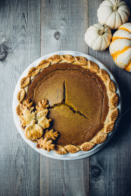 Pumpkin Pie with Decorative Gourds