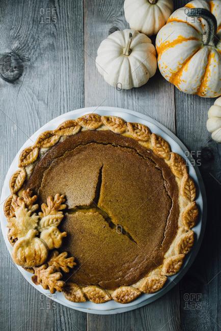 Pumpkin Pie with Decorative Gourds