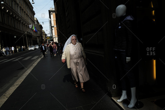 Rome, Italy - October 17, 2016: A nun walking in the street