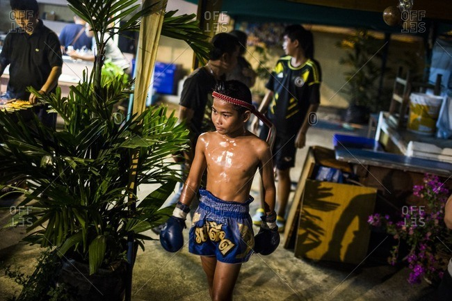 Pattaya, Thailand - February 23, 2016: Young fighter walking around stadium