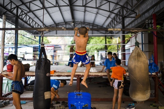 Rayong, Thailand - February 24, 2016: Boy doing pull up for boxing training