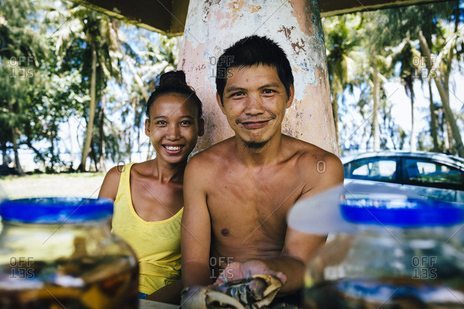 Guam, Mariana Islands - July 28, 2016: Couple at roadside food stand, Guam