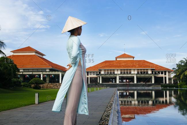 Danang, Vietnam - September 23, 2016: Woman in the grounds of resort