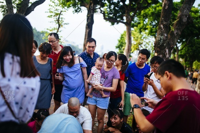 Hanoi, Vietnam - September 25, 2016: Crowds gather around Hoan Kiem Lake