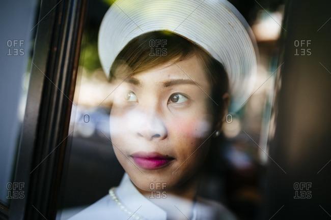 Hanoi, Vietnam - September 26, 2016: A woman in traditional dress at the Sofitel Metropole Hotel in Hanoi, Vietnam
