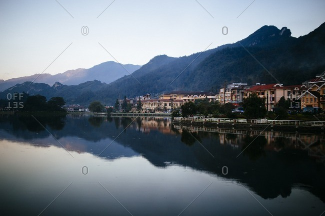 Sapa, Vietnam - September 27, 2016: Buildings and mountains reflected in lake, Vietnam