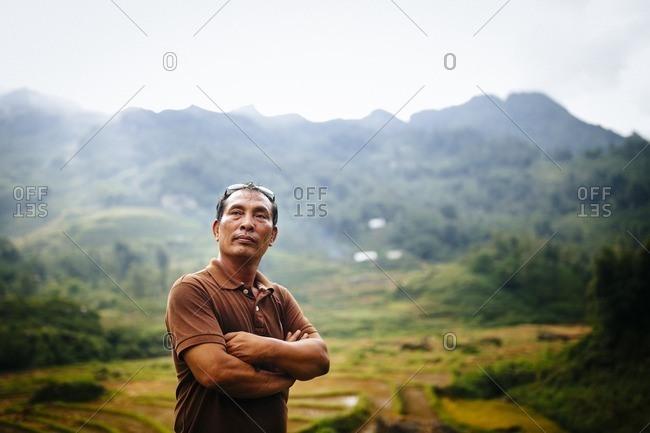 Sapa, Vietnam - September 28, 2016: Man standing in mountain setting