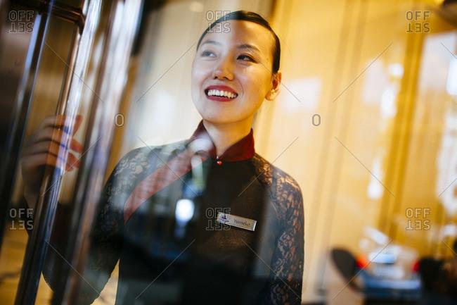 Ho Chi Minh City, Vietnam - September 30, 2016: Hotel staff member greeting at entrance