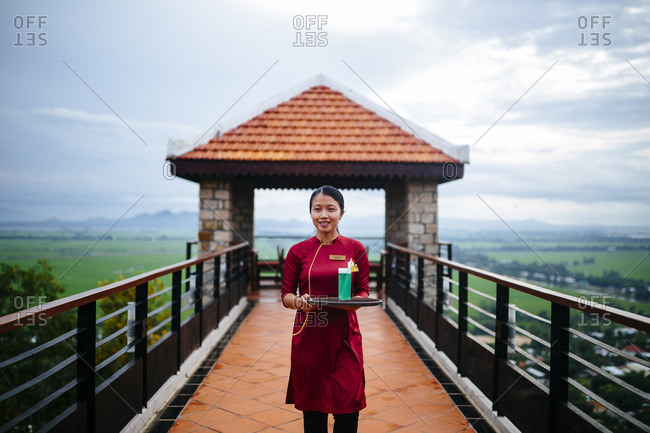 Chau Doc, Vietnam - October 1, 2016: A waitress on hotel veranda