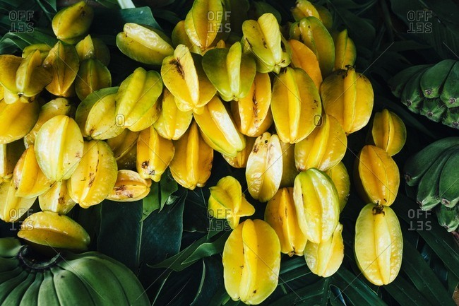 Star fruits and green bananas for sale, Guam