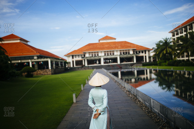 Woman in the grounds of a resort