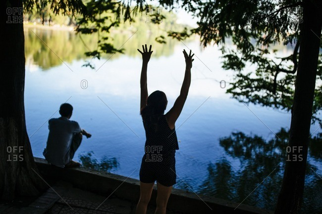 Woman stretching on Hoam Kiem Lake