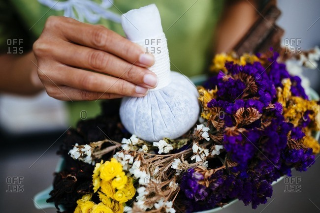 Dried flowers and massage ball at spa
