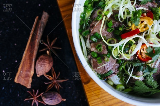 A bowl of beef pho in close up