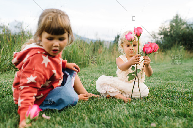 Girls sitting in country with roses