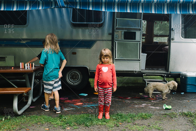Kids playing under a camper awning