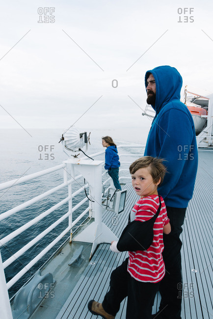 Boy in sling with dad on ferry